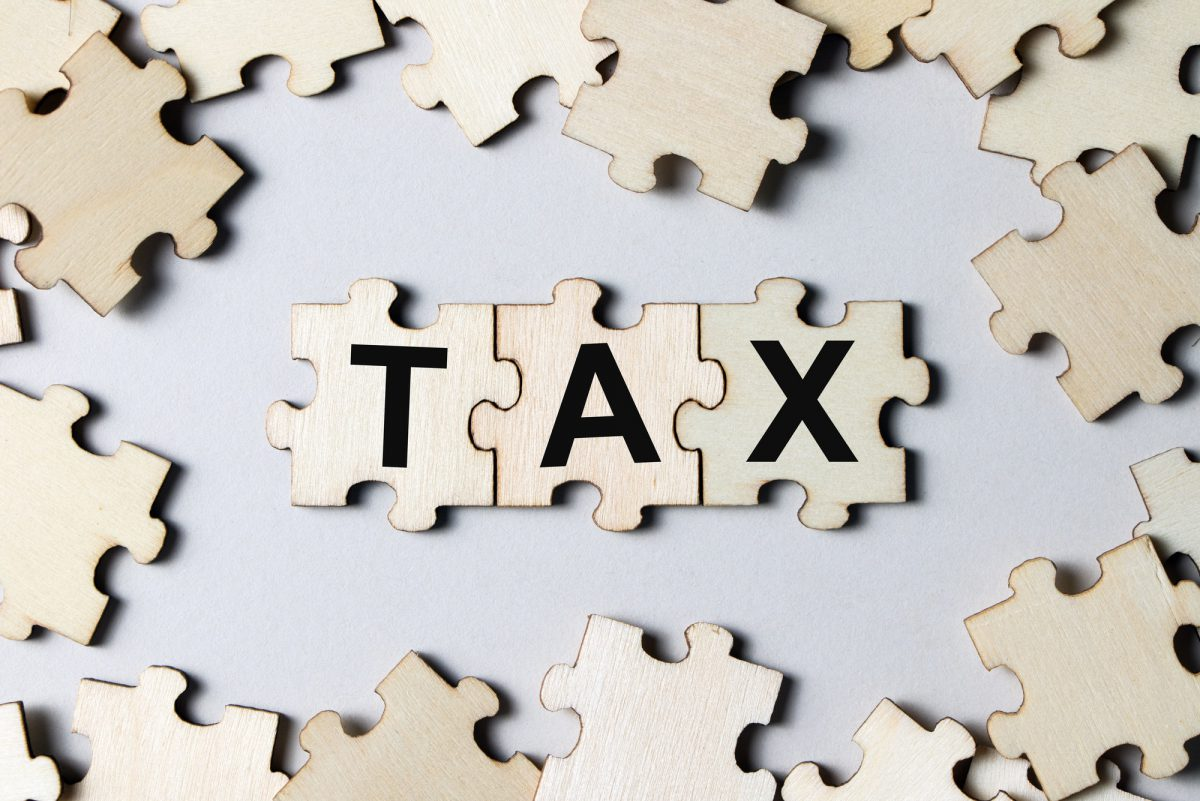 Puzzle pieces with word tax