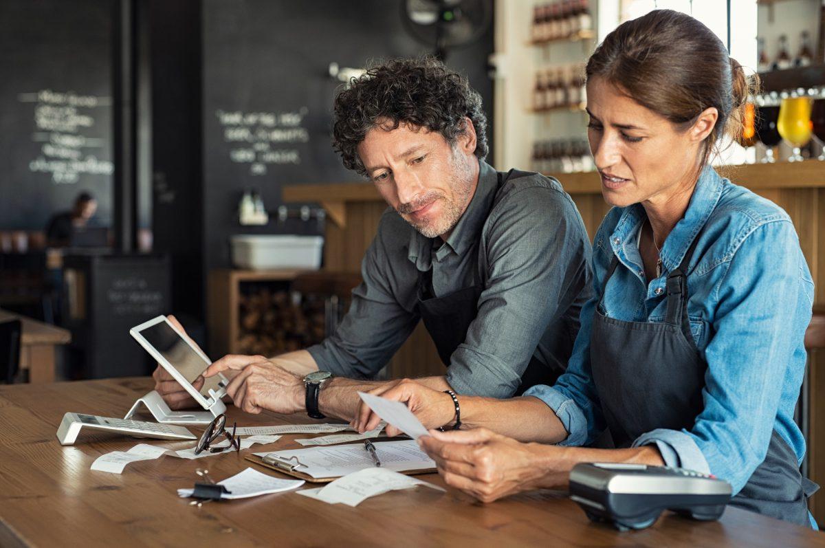Staff calculating restaurant bill
