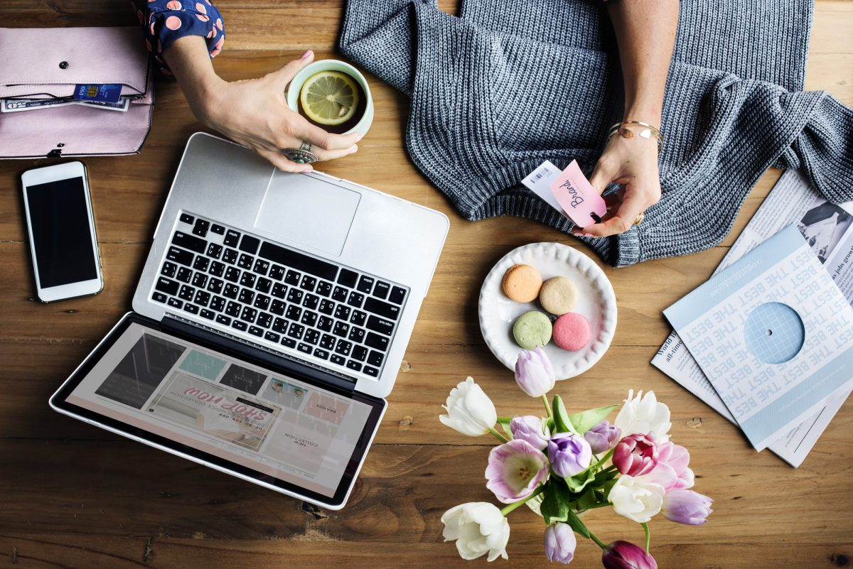 Woman Using Laptop Shopping Online