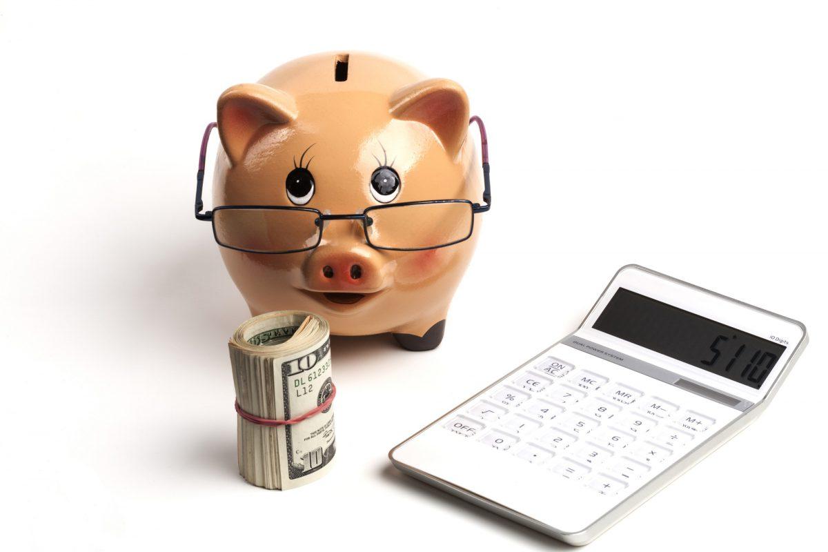 Piggy Bank With White Calculator