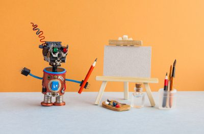 Robot artist begins to create a drawing with a pencil.