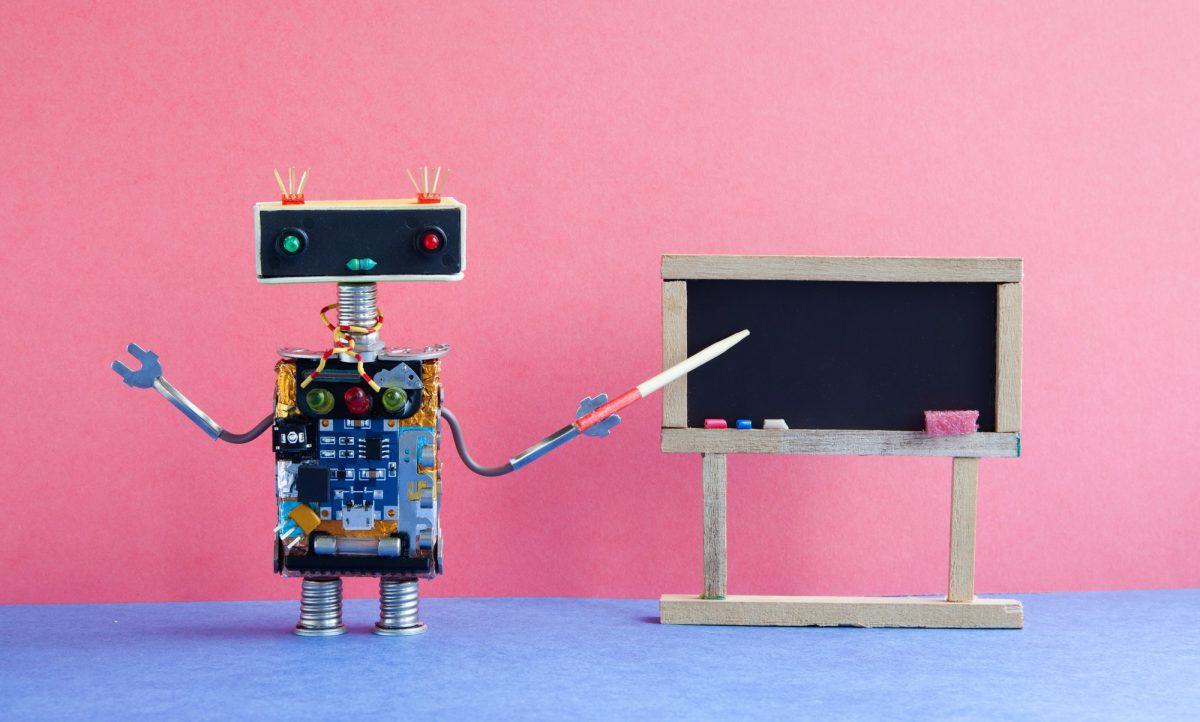 Robot teacher explains modern theory.